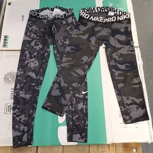 2 pairs of nike pro compression tights